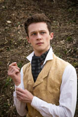 Young man looking smart in shirt and cravat