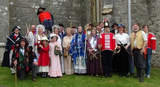Group of people in costume for the mummer's play