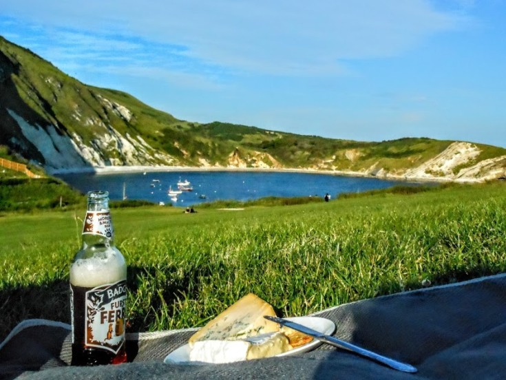 View of Lulwroth Cove, with a picnic in the foreground